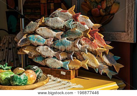 Close-up of colorful wooden sculpture of fishes in Paraty, an amazing and historic town totally preserved in the coast of the Rio de Janeiro State, southwestern Brazil
