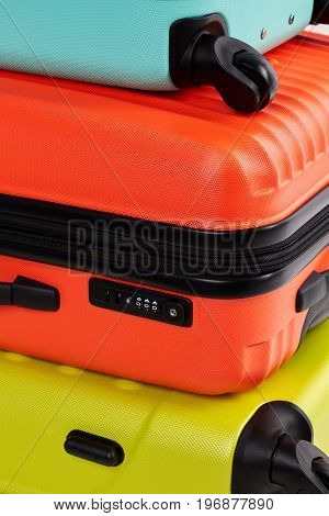Close up of colorful suitcases. Three colors of loads.