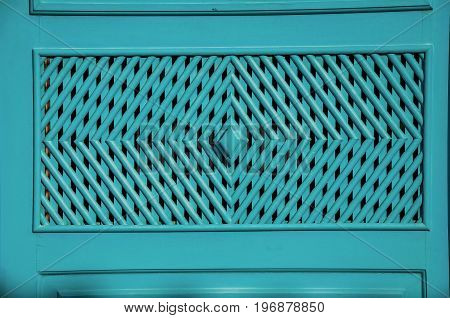 Close-up of wooden blue door in Paraty, an amazing and historic town totally preserved in the coast of the Rio de Janeiro State, southwestern Brazil