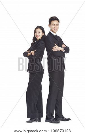 studio portrait of young asian business man and woman arms crossed looking at camera smiling isolated on white background.