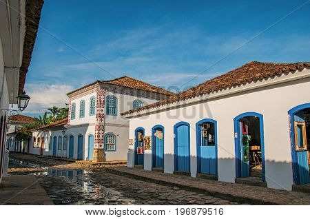 Paraty, Brazil - January 25, 2015. View of flooded cobblestone street with old houses at the sunset in Paraty, an amazing and historic town in the Rio de Janeiro State coast, southwestern Brazil