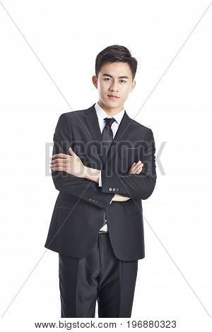 studio portrait of a young asian businessman in formal wear arms crossed isolated on white background.