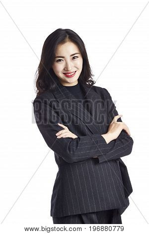 studio portrait of a young asian businesswoman in formal wear arms crossed isolated on white background.