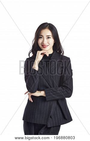 studio portrait of a young asian businesswoman in formal wear hand on chin isolated on white background.