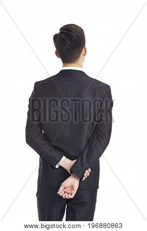 rear view of a contemplating young asian businessman studio shot isolated on white background.