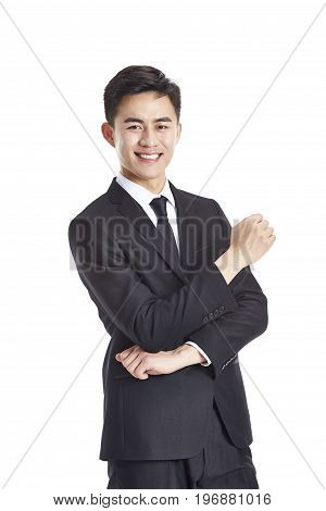 studio portrait of a young asian businessman in formal wear happy and smiling isolated on white background.