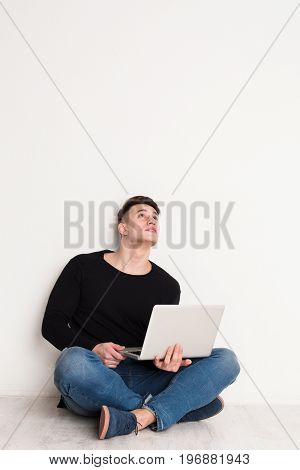Freelance work with laptop, pensive young man in casual, copy space on white