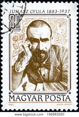 UKRAINE - CIRCA 2017: A postage stamp printed in Hungary shows Gyula Juhasz poet from series Personalities circa 1983