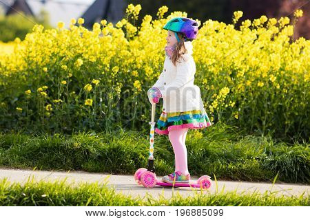 Child Riding Schooter On Way To School