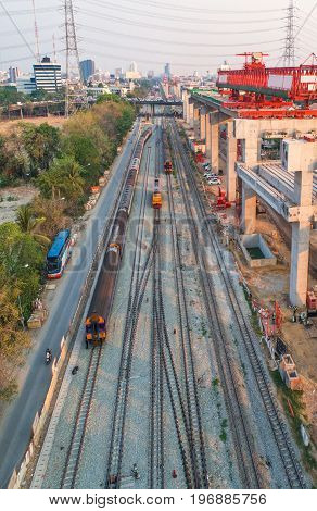 Freight and passenger train waiting at the train station parking lot.Cargo transit.import export and business logistic.Aerial view.Top view. Railway construction
