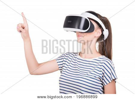 A girl in 3D virtual reality glasses enjoys his trip in an adventurous world, isolated on a white background. A concept of global web. Female action in virtual reality helmet. Digital VR device.
