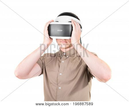 A young man using virtual reality goggles, isolated on a white background. Amazed businessman with virtual reality glasses. New and professional audio equipment.
