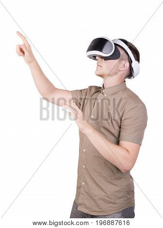 A young man is using a virtual reality headset, isolated on a white background. Professional audio equipment. A guy wearing virtual reality goggles. Male action in virtual reality helmet. VR Glasses.