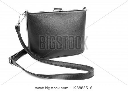 Woman's fashion luxury and leather black handbag, isolated on a white background. Black female bag with long handles. Stylish lady's handbag. An elegant girl's bag.