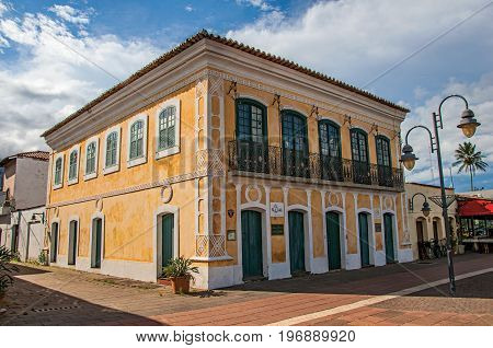 São Sebastião, Brazil - January 26, 2015. Old colorful building and blue sunny sky in São Sebastião, a nice seaside town with several tropical beaches close by. São Paulo State, southwestern Brazil