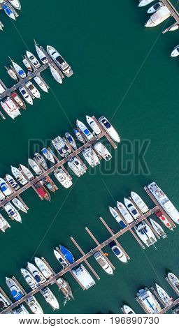 Pier speedboat. A marina lot. This is usually the most popular tourist attractions on the beach.Yacht and sailboat is moored at the quay.Aerial view by drone.Top view. poster
