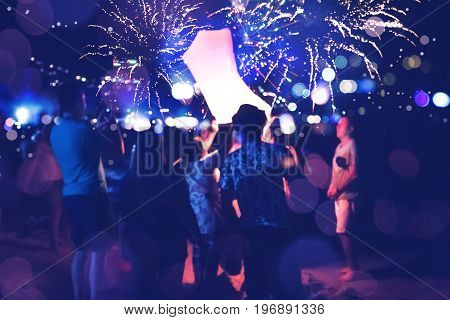 People Celebrate New Year. Fireworks circle blur. Colorful in celebration. Thailand Beach
