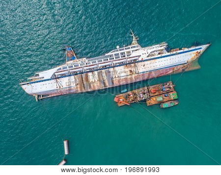 Boat crashes in the sea cruise ship accident Shipwreck top view aerial view