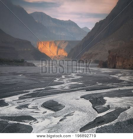 Nepal, Upper Mustang, the last sunrays in the gorge of Kali Gandaki river, the deepest gorge in the world