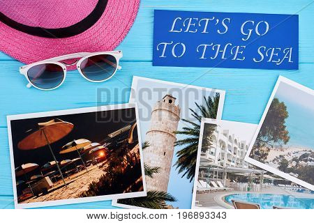 Sea vacation concept. Pink headgear, glasses, inscription, photos of resorts.