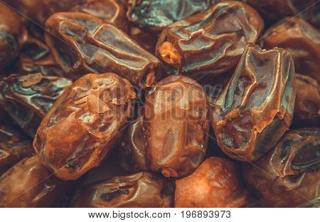 Dried fruits background dried dates close-up selective focus toned picture
