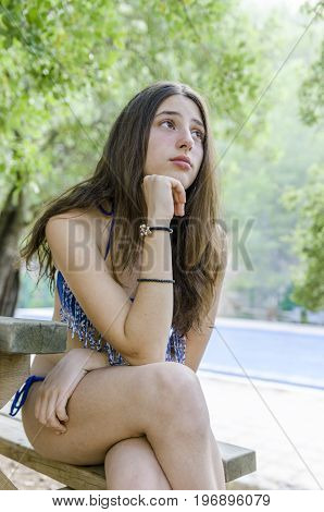 Beautiful Teenager Relaxed On Her Holidays, After Bathing In The Pool