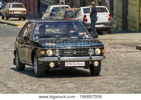 Lviv Ukraine - June 4 2017: Old retro car Tatra 613 with its owner and au unknown passenger taking participation in race Leopolis grand prix 2017 Ukraine.