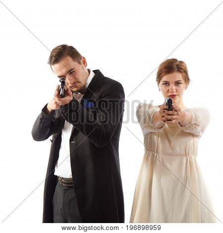 Two well-dressed young mafia couple on white background