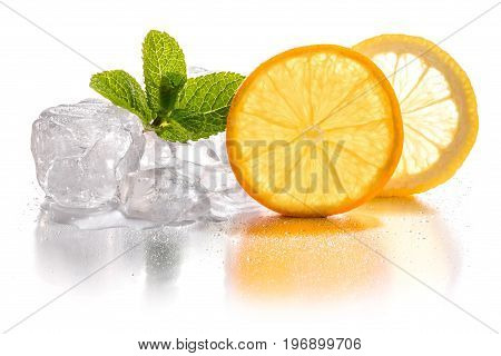 Ice cubes and slice of lemon and orange with mint leaf on white background
