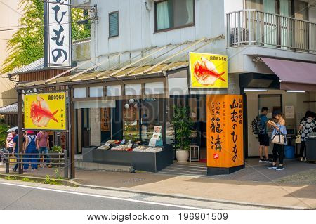 HAKONE, JAPAN - JULY 02, 2017: Unidentified people near of shoops at the streets at Hakone town.