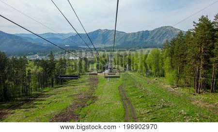 Ropeway in the gorge of the mountain altai in the summer