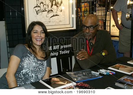 SAN DIEGO, CA - JULY 21: Marina Sirtis & Michael Dorn sign autographs on the convention floor on July 21, 2010 at the 2010 Comic Con International held in San Diego, CA.