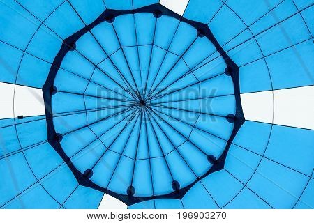 Abstract beautiful texture of a geometric surface of hot air balloon close-up. Bright blue colors. Background for bright moments of life