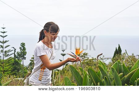 Young Woman With Flower Of Strelitzia