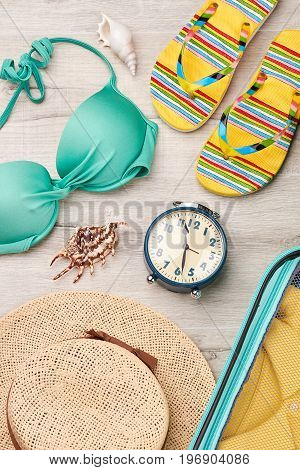 Time to have marine summer rest. Beach items on wooden background.
