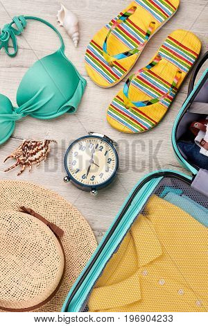 Beach fashion look, wooden background. Summer tour with fashionable accessories.