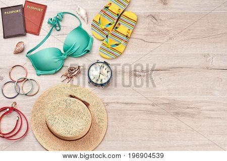 Beach accessories stuff, wooden space. Positive vacation with stylish summer items.
