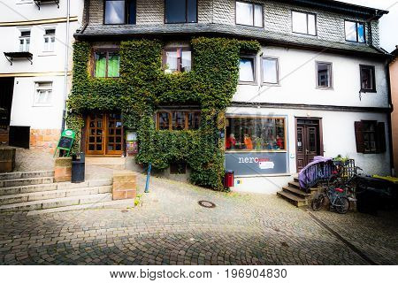MARBURG GERMANY - APRIL 18 2015: Historic streets of the old quarters of Marburg. District Oberstadt. Toning. Stylization. Vignetting. Marburg is a university town in the German federal state (Bundesland) of Hessen.
