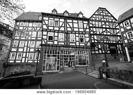 MARBURG GERMANY - APRIL 18 2015: Historic streets of the old quarters of Marburg. District Oberstadt. Black and white. Marburg is a university town in the German federal state (Bundesland) of Hessen.