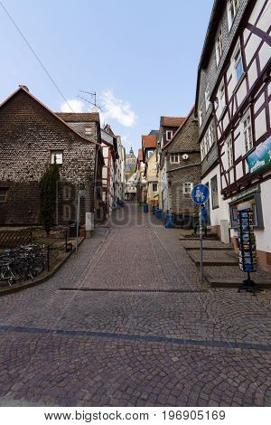 MARBURG GERMANY - APRIL 18 2015: Historic streets of the old quarters of Marburg. District Oberstadt. Marburg is a university town in the German federal state (Bundesland) of Hessen.
