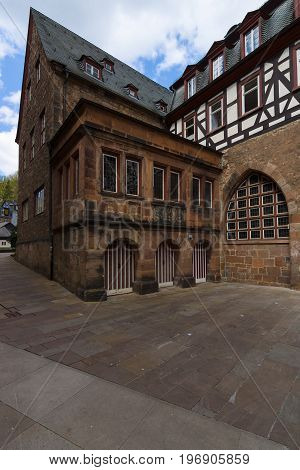 MARBURG GERMANY - APRIL 18 2015: Building in the courtyard of the Church of St. Elizabeth. The medieval church was built by the Order of the Teutonic Knights in honour of St. Elizabeth of Hungary.