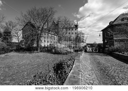 MARBURG GERMANY - APRIL 18 2015: The Marburger Schloss (Marburg castle) is the first residence of Landgraviate of Hesse. Black and white.