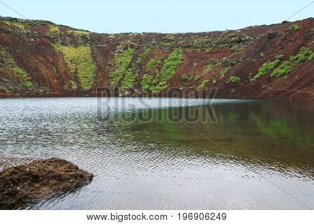 Kerid is a volcanic crater lake located in the Grimsnes area in south Iceland on the popular tourist route the Golden Circle.