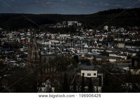 MARBURG GERMANY - APRIL 18 2015: The new and the old part of the city from the surrounding hills. Toning. Stylization. Marburg is a university town in the German federal state (Bundesland) of Hessen.