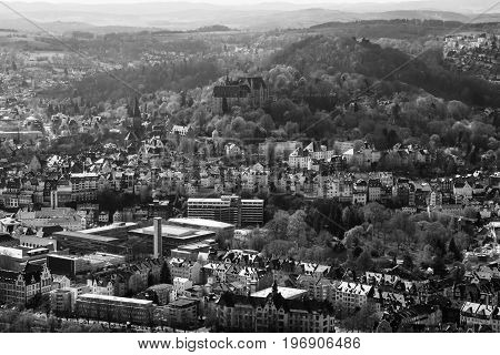 MARBURG GERMANY - APRIL 18 2015: The new and the old part of the city from the surrounding hills. Black and white. Marburg is a university town in the German federal state (Bundesland) of Hessen.