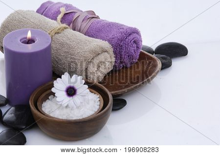 Spa setting with rolled towel, gerbera,salt in bowl