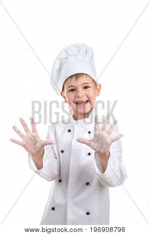 funny kid chef with flour on his hands.