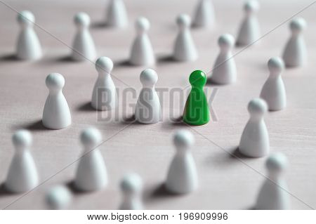 One different board game pawn. Individuality, independence, leadership and uniqueness concept. Stand out from the crowd. Think outside the box. Dare to be different.