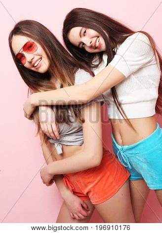 emotions, people, teens and friendship concept - happy smiling pretty teenage girls or friends hugging