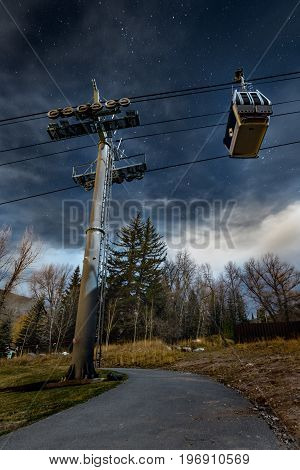Walking along a path in Vail Colorado looking at the ski lift and the stars in the night sky during the fall.